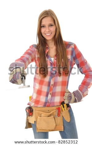 Young woman with long hair is working with a trowel - stock photo