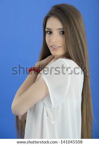 Young Woman with long Hair on blue background
