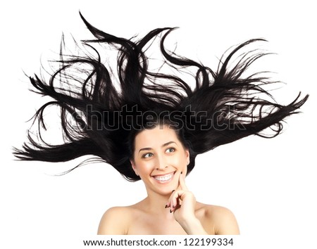 Young woman with long splayed hair - stock photo
