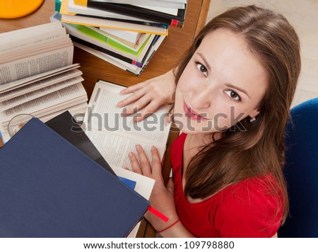 Young woman with lot of books. Reading a books.