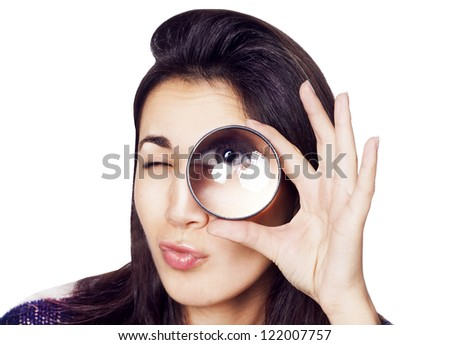 Young woman with magnifying glass over isolated background