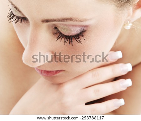 Young woman with make up and manicure