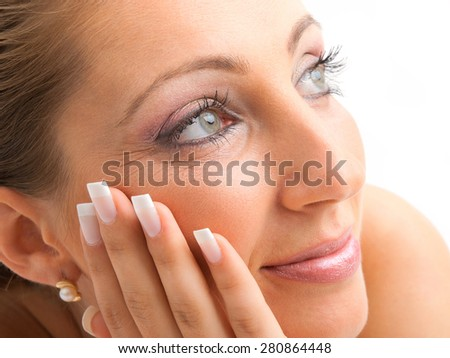 Young woman with make up and manicure isolated on white
