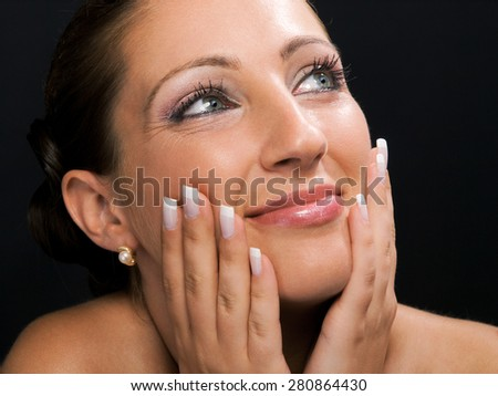 Young woman with make up isolated on black