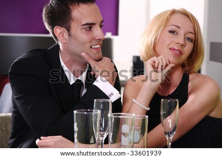 young woman with man sitting in a Bar