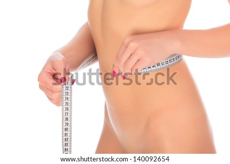 young woman with measure tape. white background, copyspace