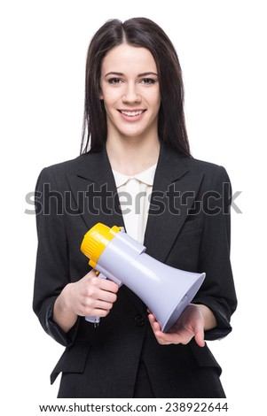 Young woman with megaphone on white background. - stock photo