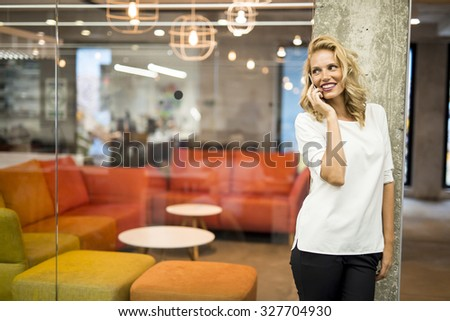 Young woman with mobile phone - stock photo
