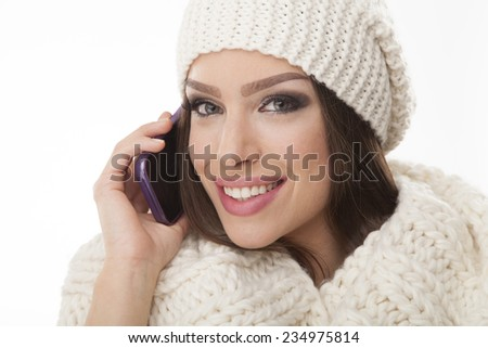 Young  woman with mobile phone in talk - stock photo