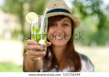 Young woman with mojito drink - stock photo