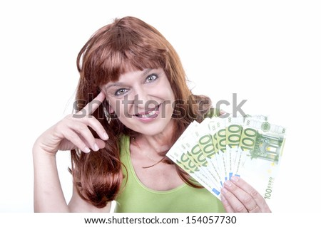 young woman with money isolated - stock photo