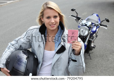 Young woman with motorcycle and French license - stock photo