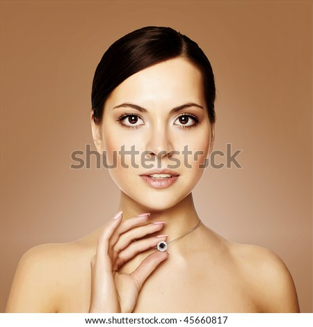 young woman with necklace, studio shot - stock photo
