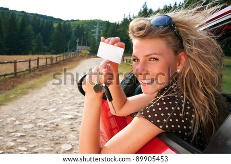 Young woman with new car and car keys - stock photo