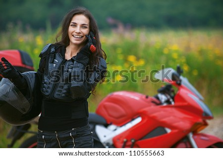 Young woman with nice bike on road.