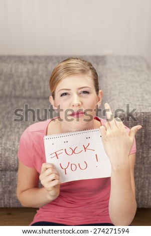 Young woman with notepad, fuck you, giving the finger