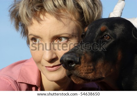 Young woman with old dobermann dog