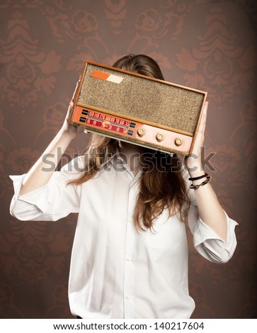 young woman with old retro radio - stock photo