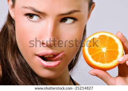 young woman with orange slice - stock photo