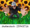 young woman with outstretched arms in a field - stock photo