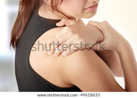 Young woman with pain in her back. - stock photo