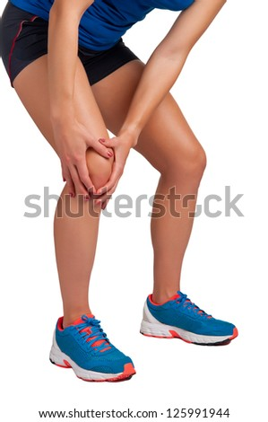 Young woman with pain in her knee, isolated in white - stock photo