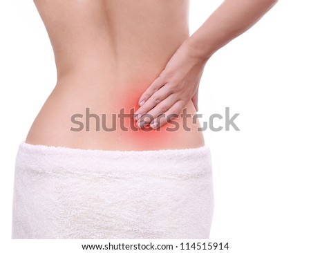 young woman with pain in her lower back isolated on white, backache - stock photo