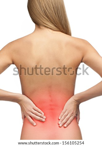 Young woman with pain in her lower back, isolated on white background