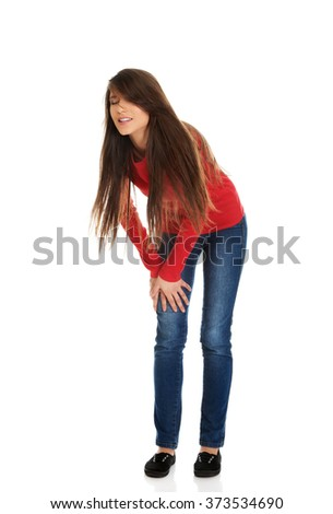 Young woman with pain in knee. - stock photo