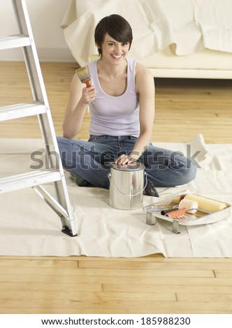 Young Woman with Painting Tools - stock photo