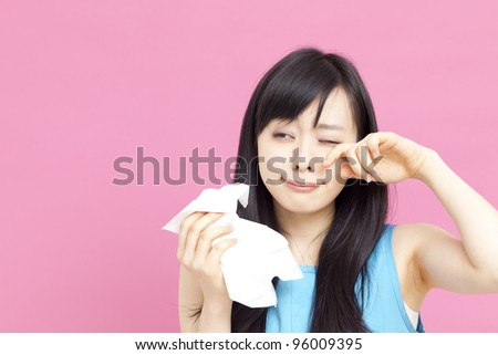 young woman with paper tissue - stock photo