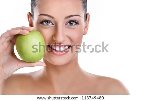 young woman with perfect healthy smiling holding green apple - stock photo