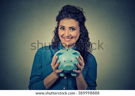 Young woman with piggy bank - stock photo