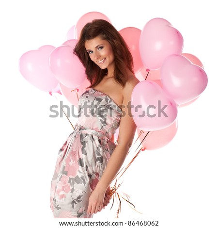 Young woman with pink balloons isolated on white - stock photo