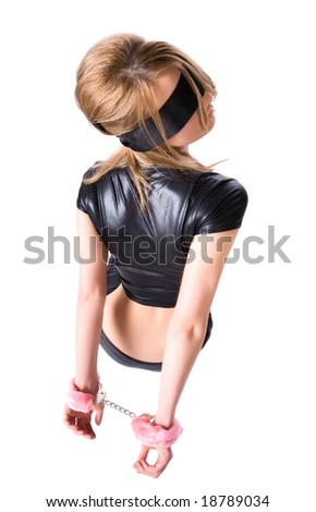 Young woman with pink handcuffs. Backside view. - stock photo