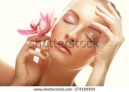 young woman with pink orchid - stock photo