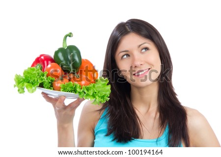 Young woman with plate of fresh healthy vegetarian vegetables salad, peppers, tomatoes isolated on a white background