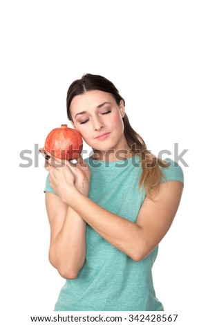 Young woman with pomegranate