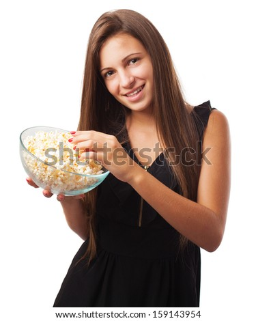 young woman with popcorn isolated on white background - stock photo