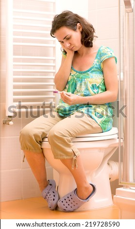 Young woman with pregnancy test - stock photo