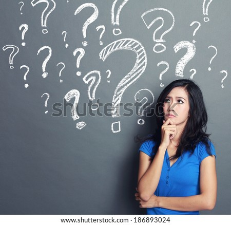 young woman with question mark on a gray background