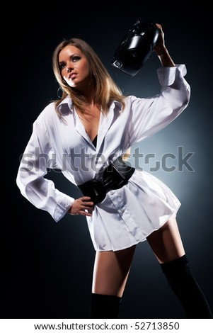 Young woman with radio fashion. On dark background. - stock photo