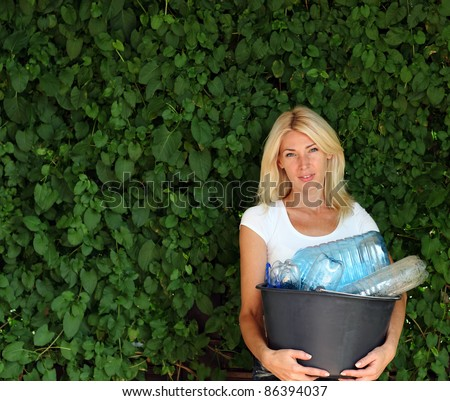 Young woman with recycling box. Copy space - stock photo