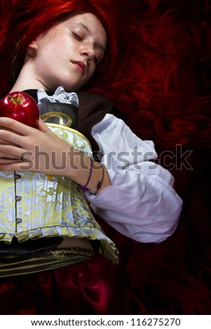 Young woman with red apple in a poetic representation - stock photo