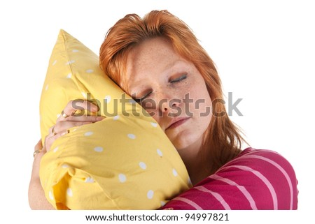 Young woman with red hair is sleeping