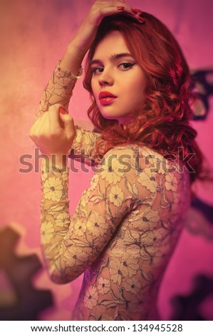 Young woman with red hair portrait. Soft pink tint. - stock photo