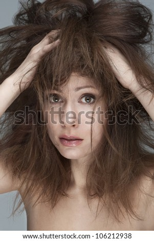 Young woman with refractory problem hair - stock photo