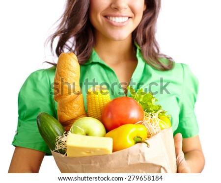 Young woman with sack of healthy products - stock photo