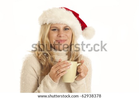 Young woman with Santa hat and coffee cup