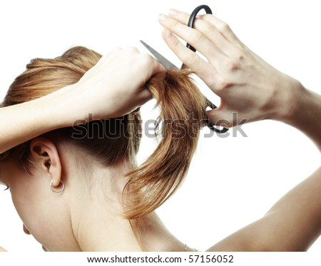 Young woman with scissors going to cut her hair
